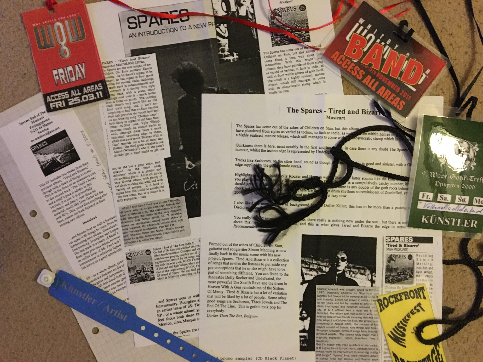 Scrap book, reviews, backstage passes and other tour memorabilia scattered about